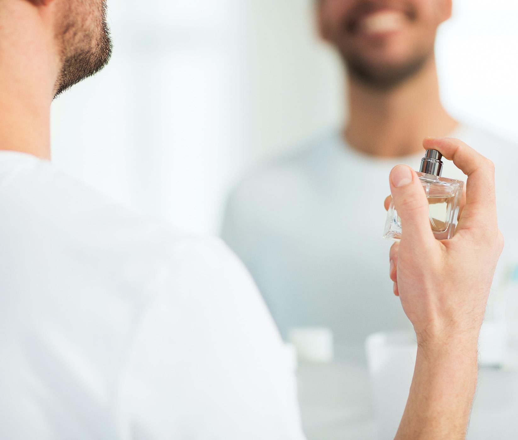 parfums plus close up of man perfuming with perfume at bathroom